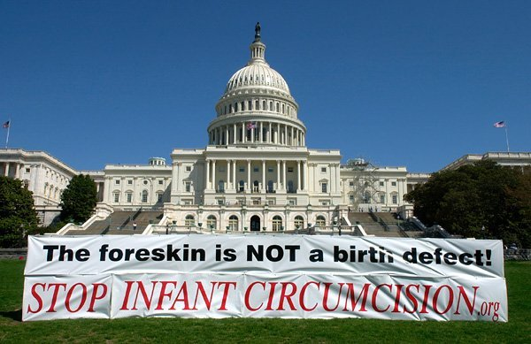"A picture of the Capitol building of the United States of America with a large baner stating "" The foreskin is NOT a birth defect! STOP INFANT CIRCUMCISION.org """